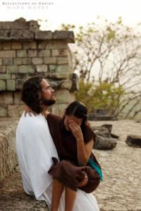 Jesus holding a girl